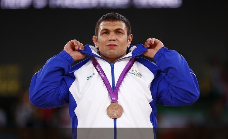 طلای المپیک به کشتی گیر ایرانی رسید